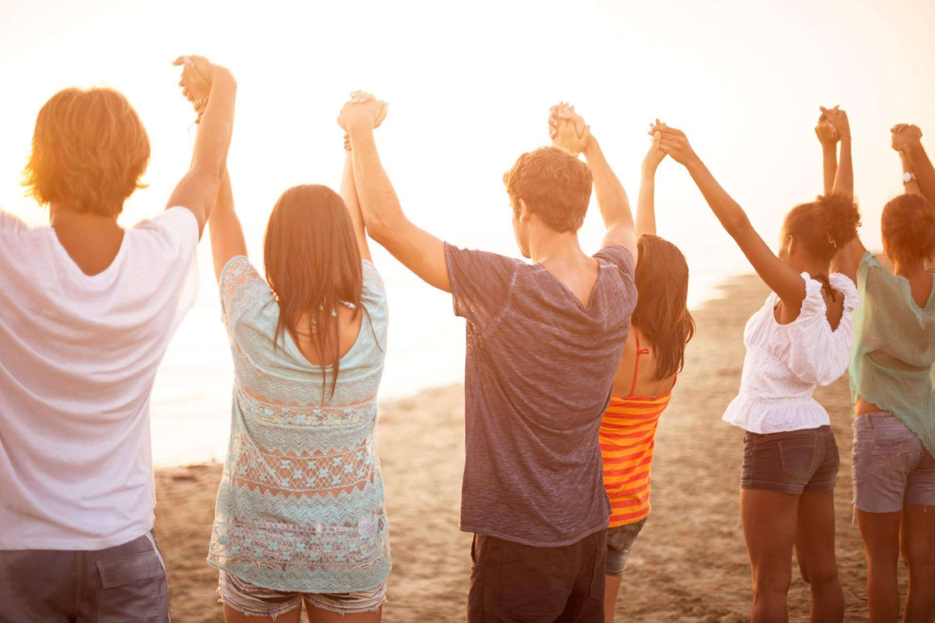 People-holding-hands-Beach-iStock-482877799-cropped2-1
